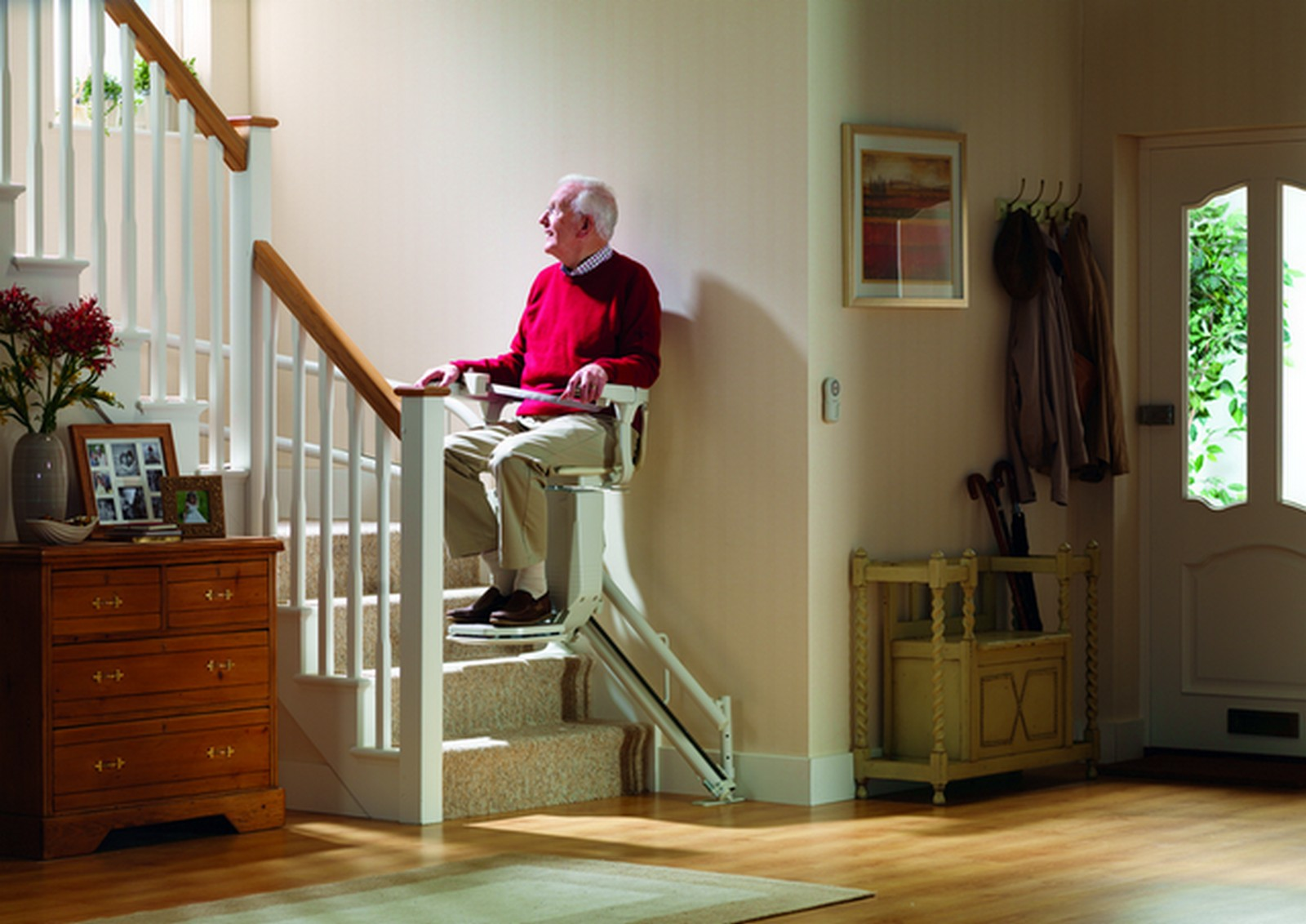 Elderly gentleman sat on a stairlift